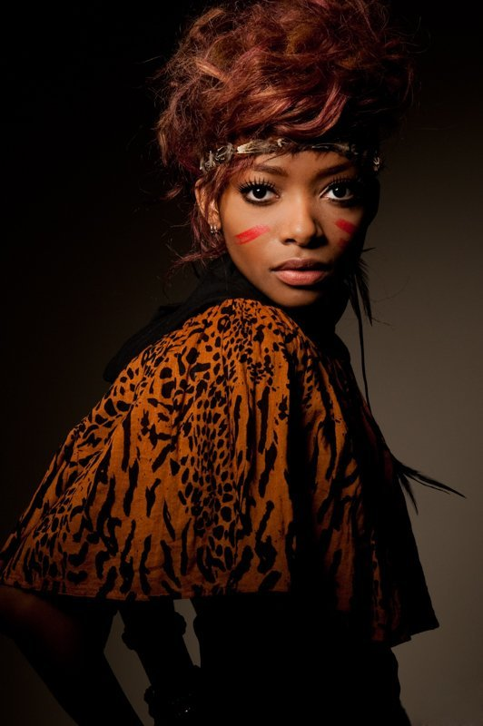 Dramatic portrait of young woman with animal print shawl