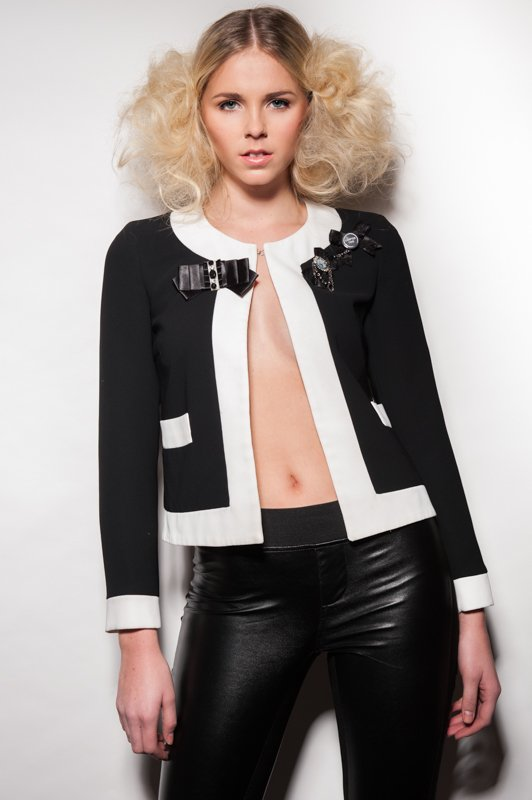 Model wearing black and white outfit
