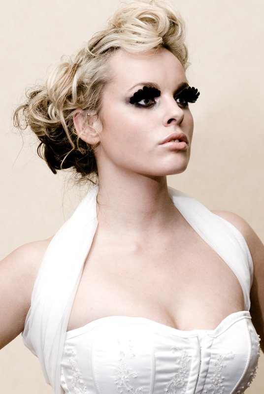 Bridal style beauty picture with black feather eyelashes
